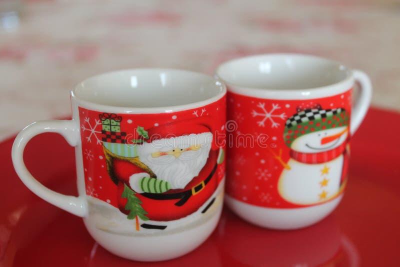 Två jultekoppar Julkoppar royaltyfria foton
