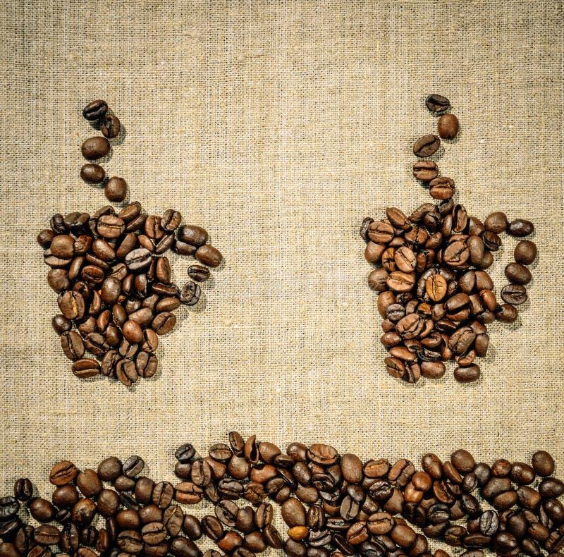 Två kaffekoppar på bakgrunden av linneborddukar Gullig menydesign royaltyfria bilder