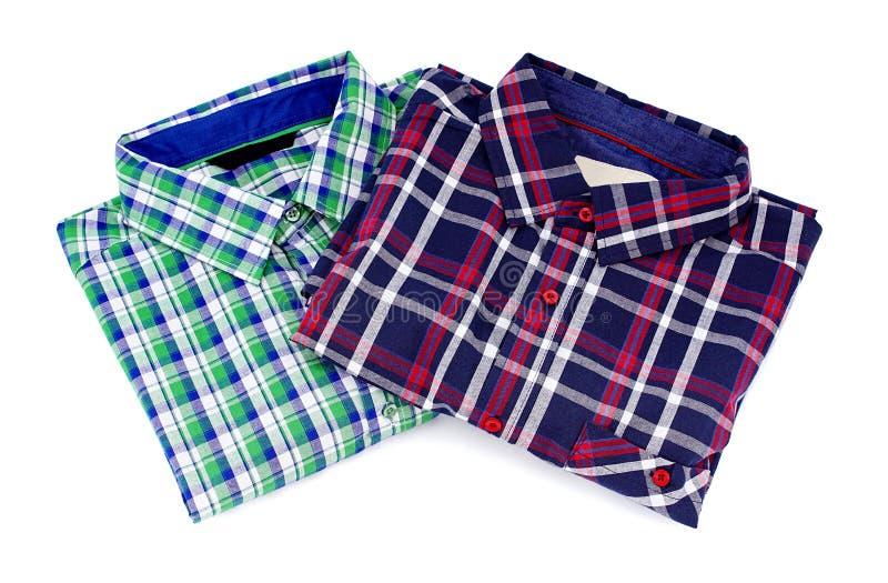Två kulöra skjortor med modellen royaltyfri fotografi