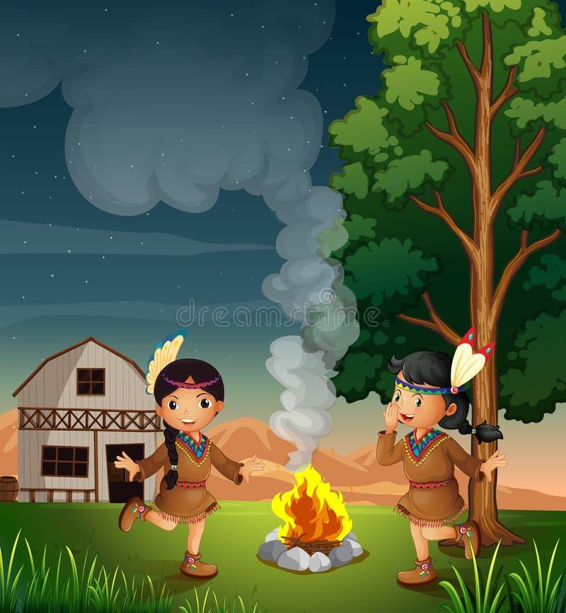 Två lilla indier med en lägereld vektor illustrationer