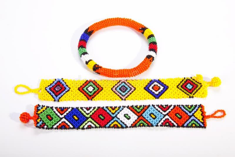 Två ljust färgade Zulu Wristbands med den prydde med pärlor armbindeln royaltyfria foton