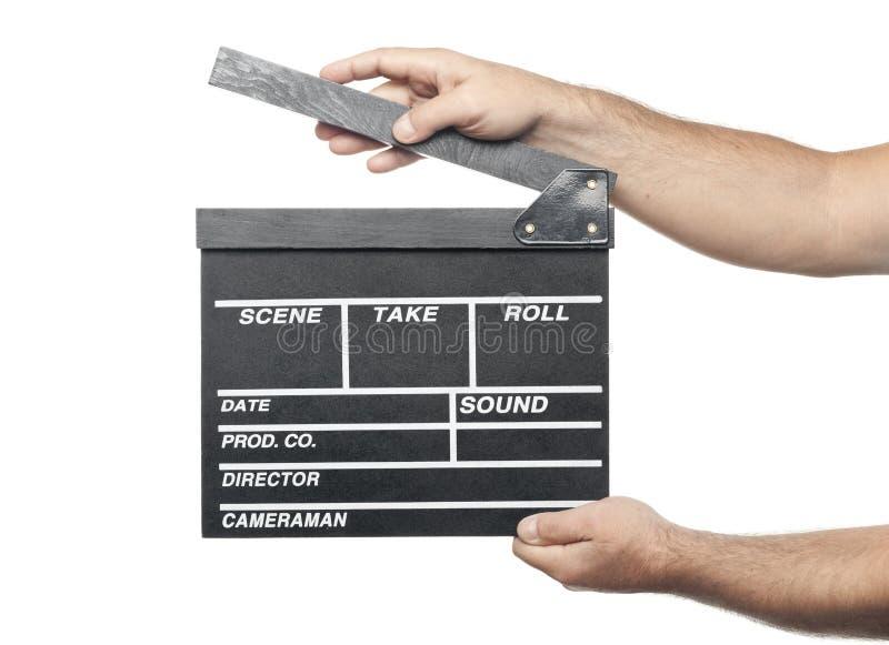 Två manliga händer som rymmer brädet för filmproduktionclapper isolerat arkivfoto