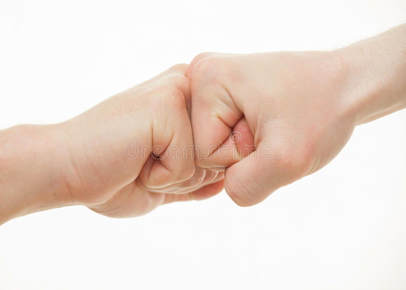 Två manliga händer som visar en gest av en tvist arkivfoto
