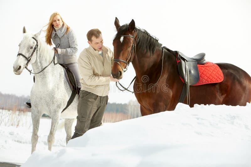 Två med hästar arkivbild