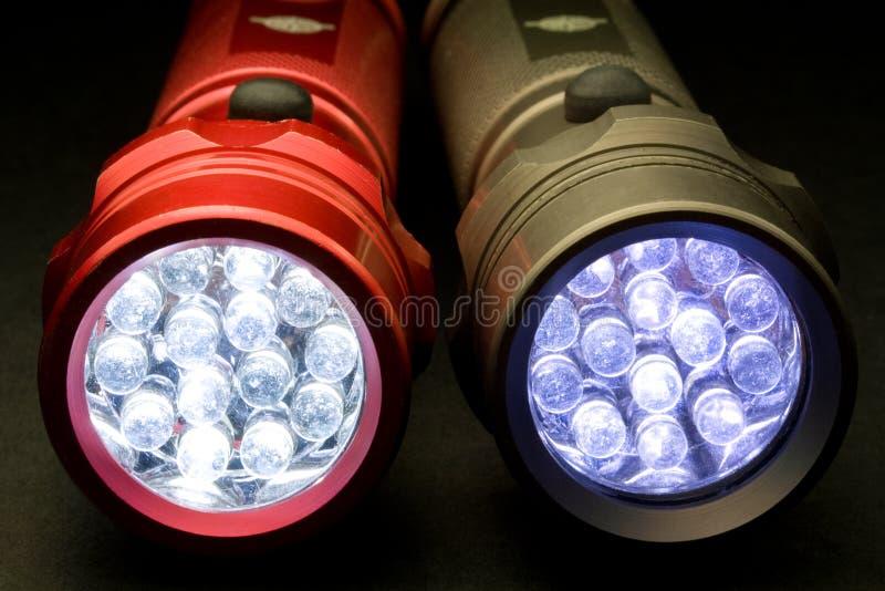 Två moderna ljusdiod-ficklampor arkivfoto