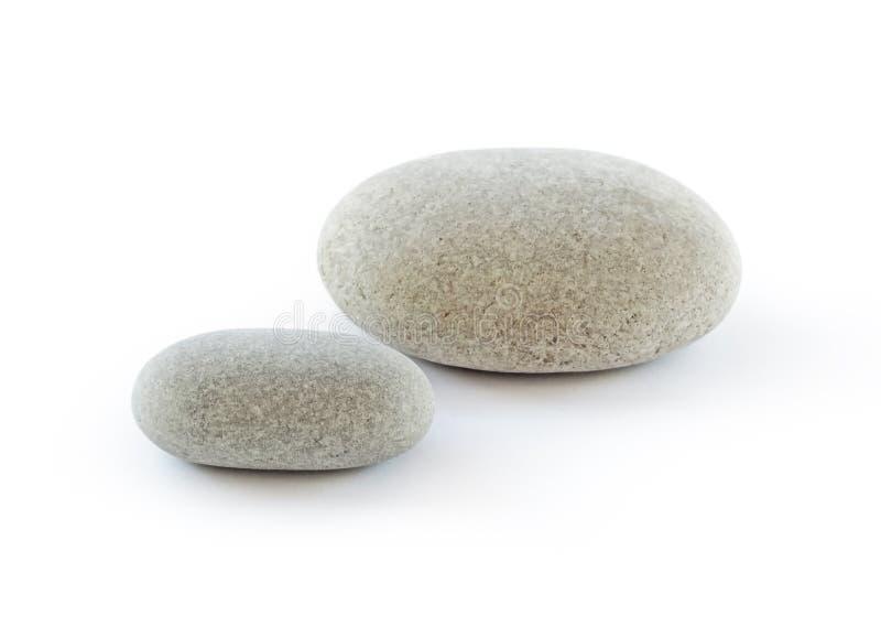 Två pebbles på vit bakgrund royaltyfri foto