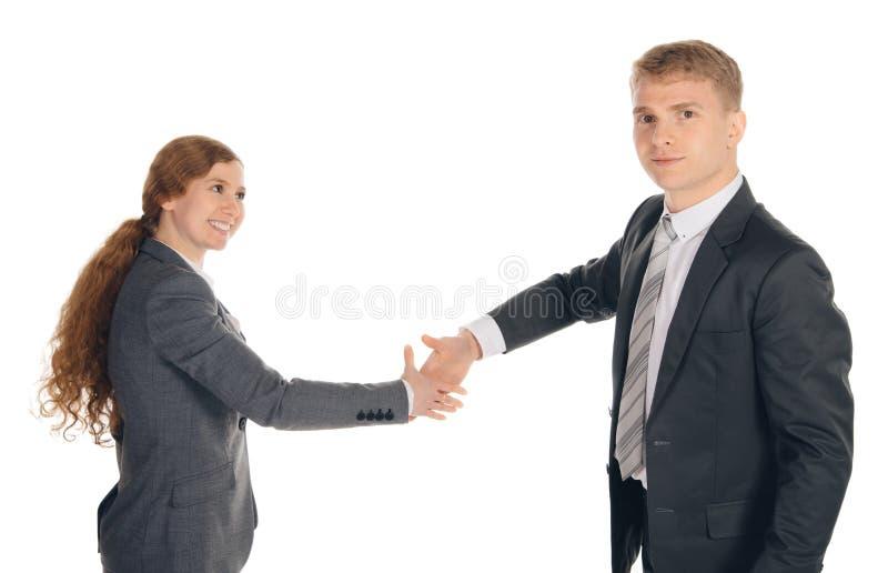 Två personer i dräkter som ges händer royaltyfri bild