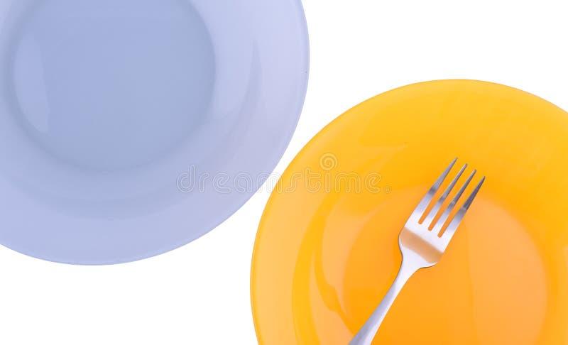 Två plattor och en gaffel royaltyfria foton