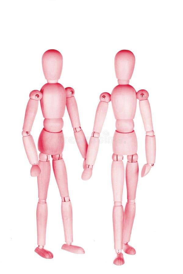 Två rosa träpysslingar royaltyfri bild