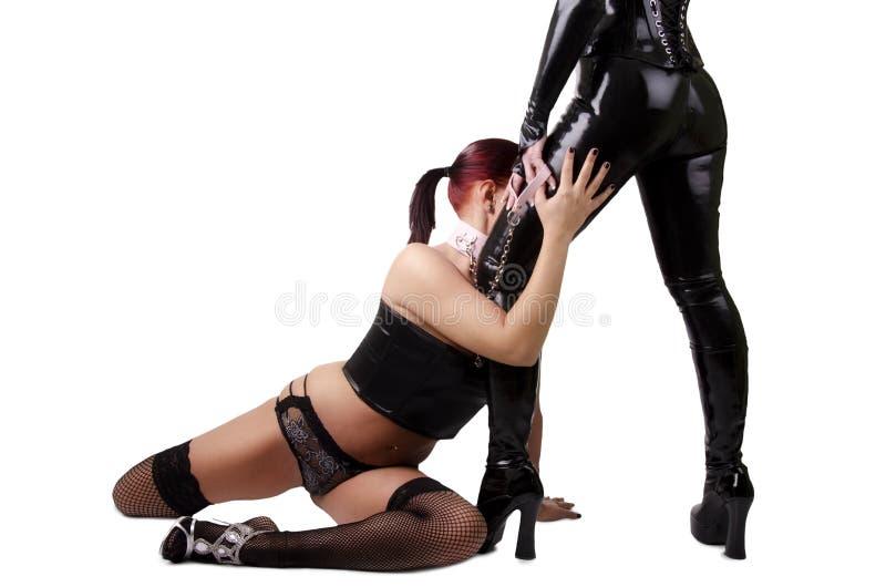 Två sexiga kvinnor fotografering för bildbyråer