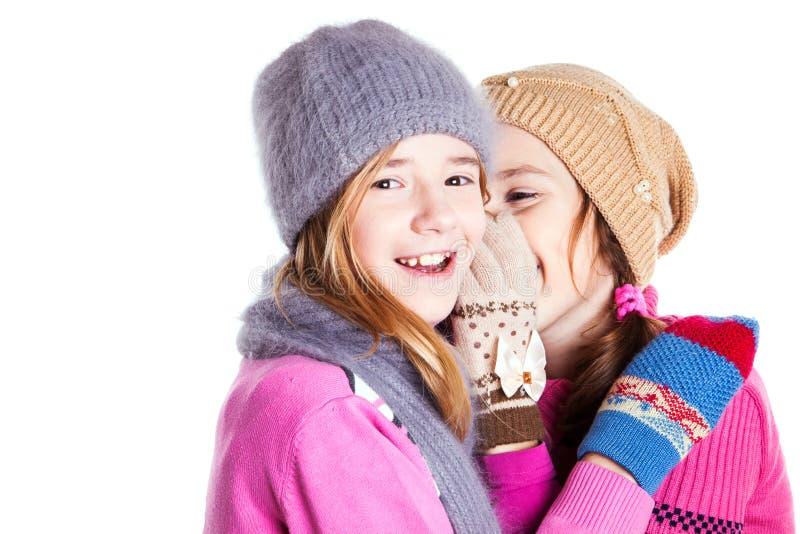 Två små flickor pratar arkivbilder