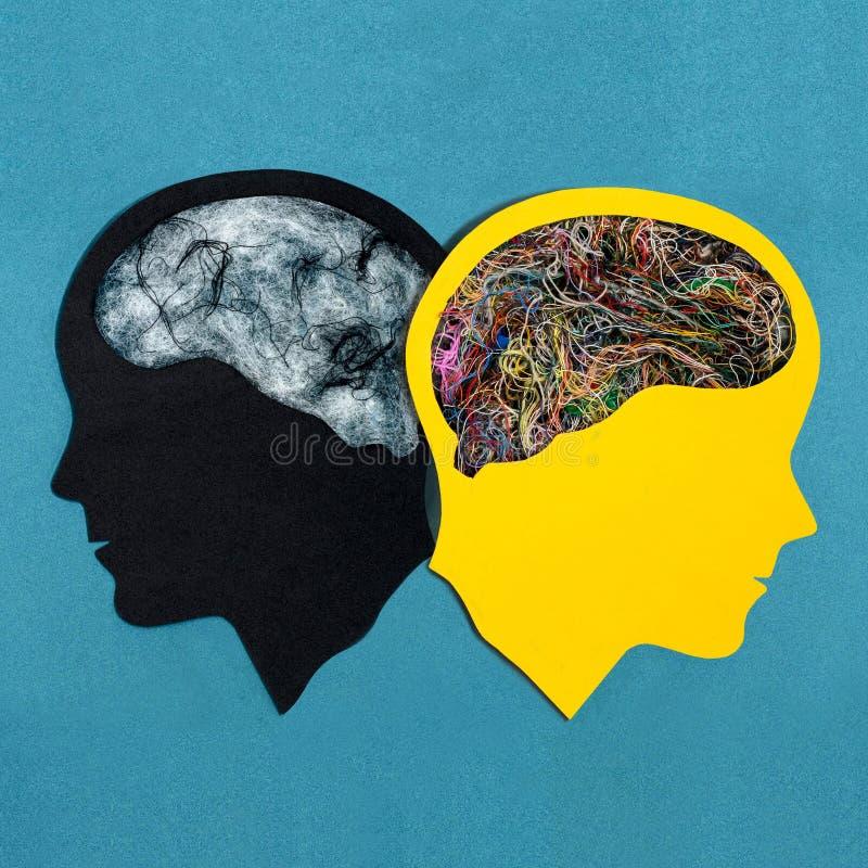Två stiliserade huvudkonturer bipolär oordning arkivbild