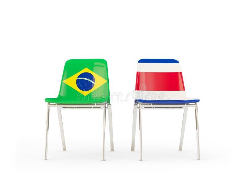 Två stolar med flaggor av Brasilien och Costa Rica stock illustrationer