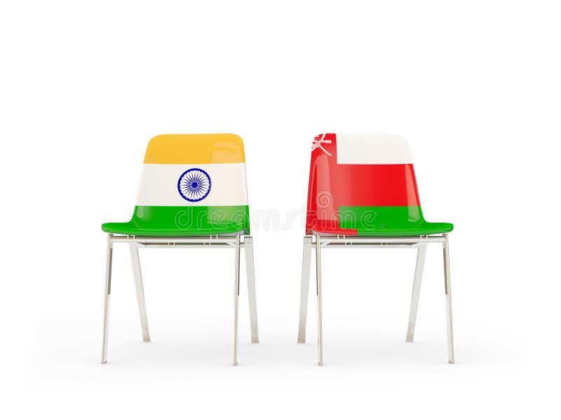 Två stolar med flaggor av Indien och Oman stock illustrationer
