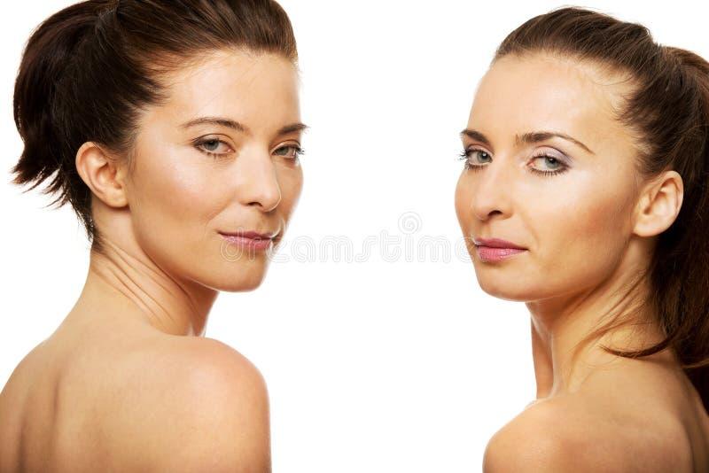 Två systrar med smink royaltyfri foto