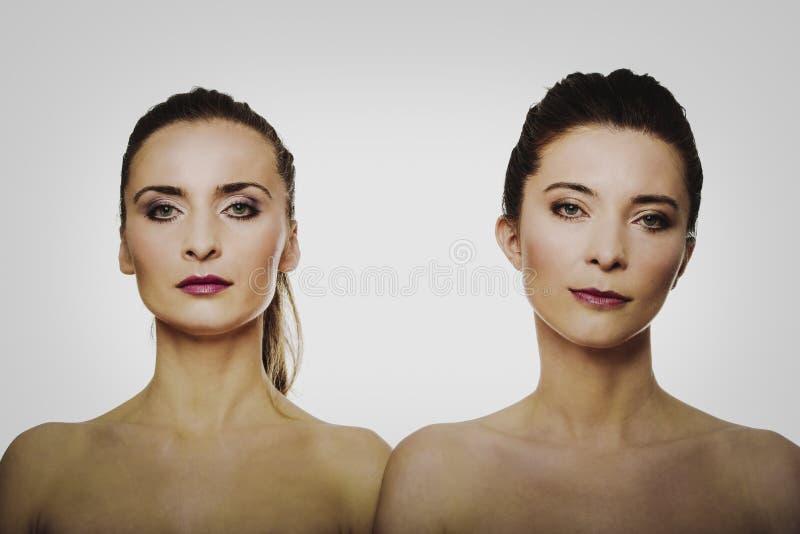 Två systrar med smink arkivfoton