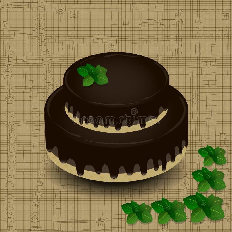 Två-tiered chokladkaka med en kvist av mintkaramellen arkivbilder