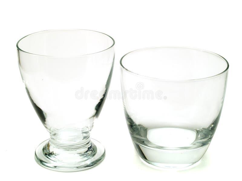 Två tomma coctailexponeringsglas arkivbilder