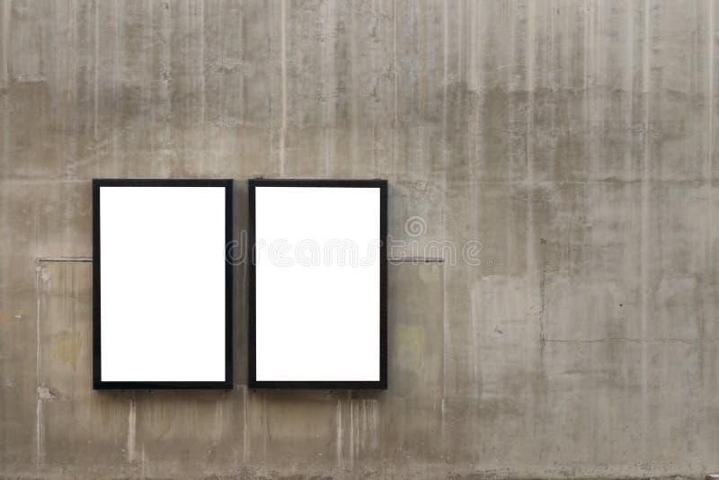 Två tomma ramar eller affischtavlaaffischer arkivfoton