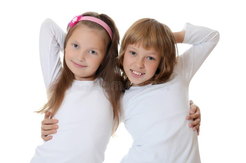 Två ung flickavänner arkivfoton