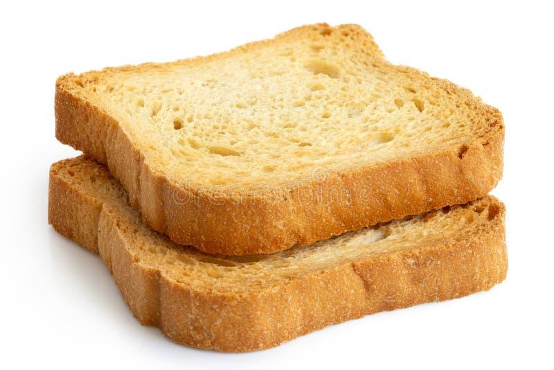 Två vanliga melbarostade bröd som isoleras på vit royaltyfria foton