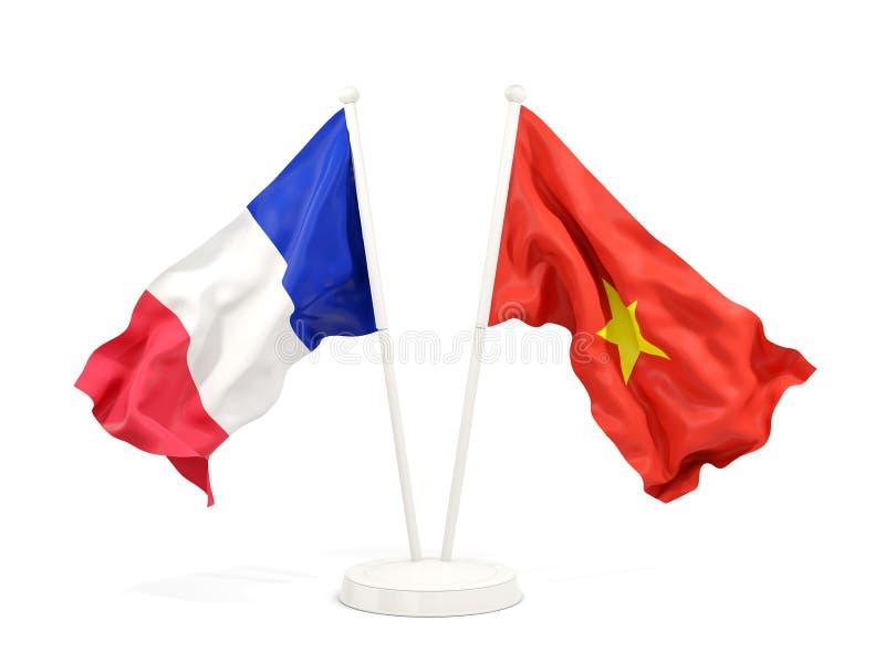 Två vinkande flaggor av Frankrike och Vietnam som isoleras på vit vektor illustrationer