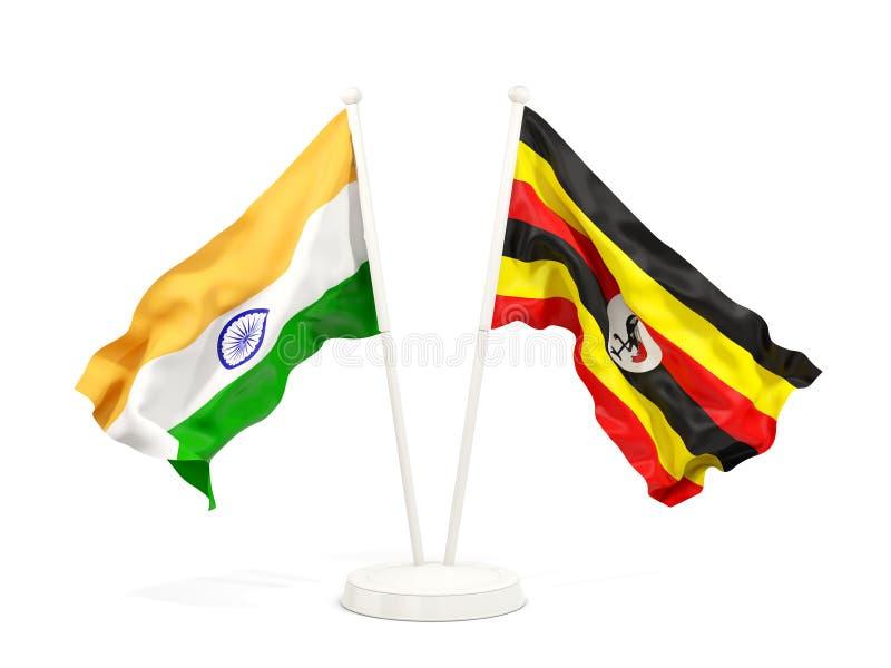Två vinkande flaggor av Indien och Uganda som isoleras på vit stock illustrationer