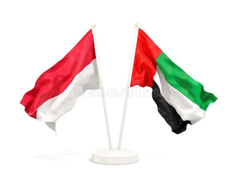 Två vinkande flaggor av Indonesien och Förenade Arabemiraten som isoleras på vit stock illustrationer