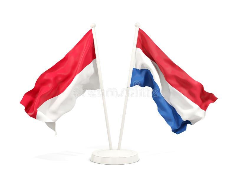 Två vinkande flaggor av Indonesien och Nederländerna som isoleras på vit vektor illustrationer
