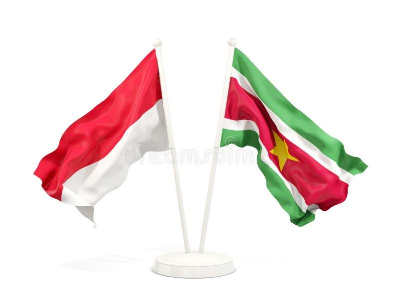 Två vinkande flaggor av Indonesien och Surinam som isoleras på vit stock illustrationer