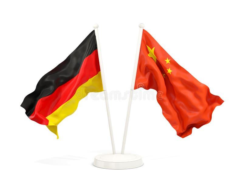 Två vinkande flaggor av Tyskland och porslin stock illustrationer