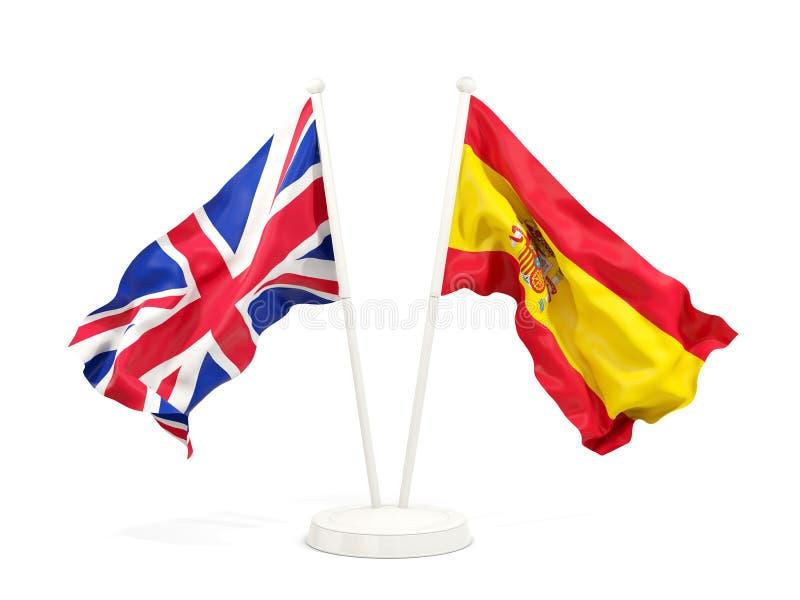Två vinkande flaggor av UK och Spanien stock illustrationer