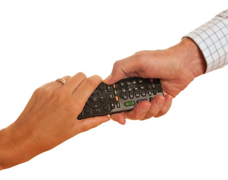 TV à télécommande - homme et femme, d'isolement photographie stock