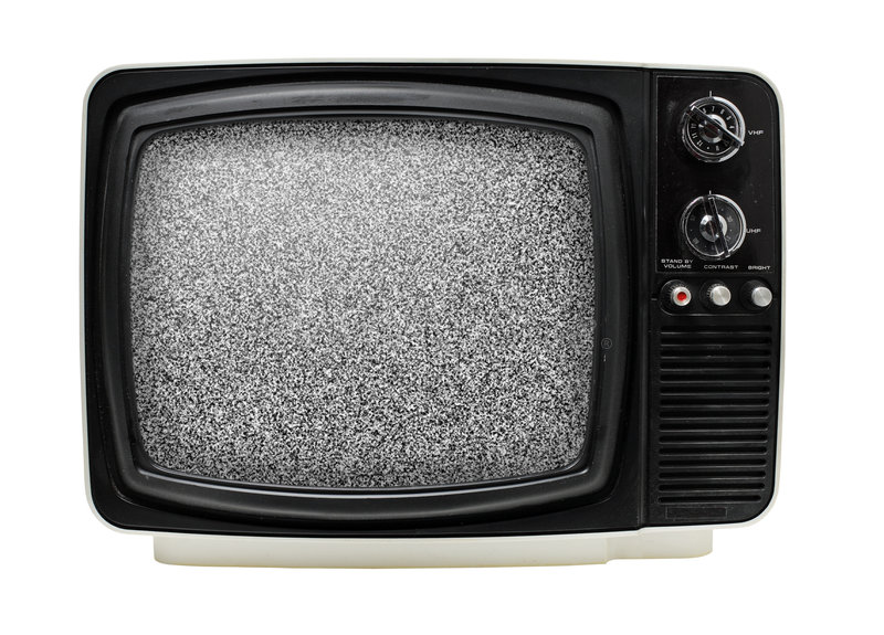 TV. Old 12 black & white portable television, dusty and dirty. Isolated on white. Some static noise added on the screen in post-production stock images