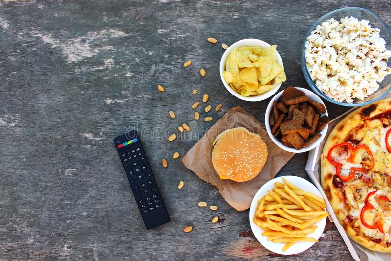 TV-afstandsbediening, snel voedsel stock foto