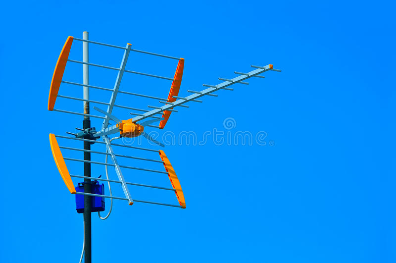 TV antenna. Against blue sky background royalty free stock image