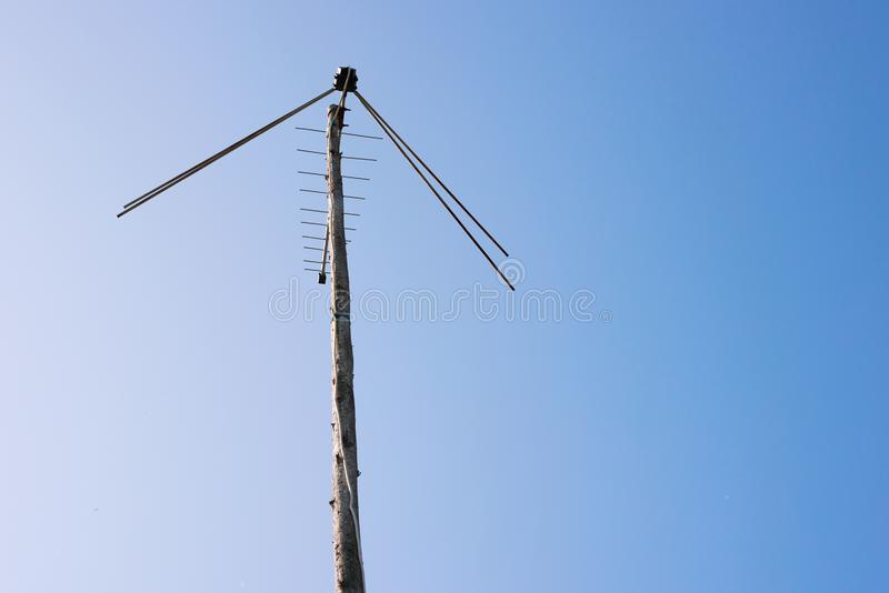 TV antenna attached to a wooden pole. Is close royalty free stock photo