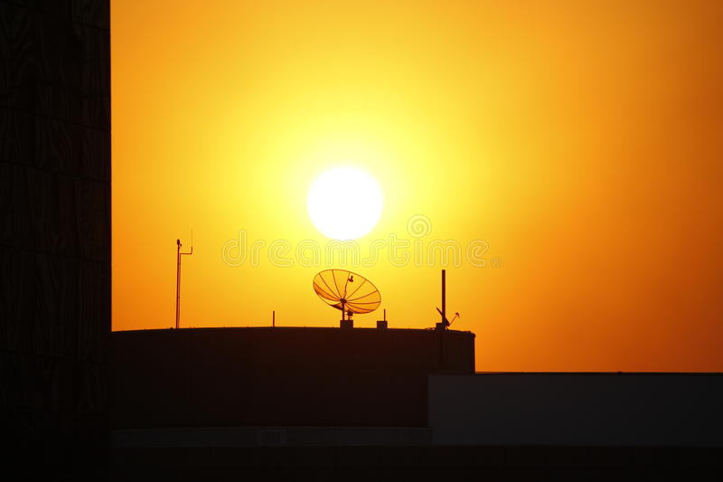 TV antenna in front of the sun royalty free stock image