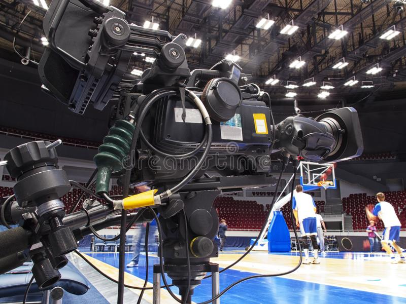 Tv camera before the broadcast of the basketball match. stock photos