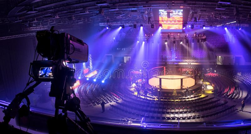 Tv camera in competitions in mixed martial arts. Octagonal for fights without rules, tv camera in competitions in mixed martial arts stock photos