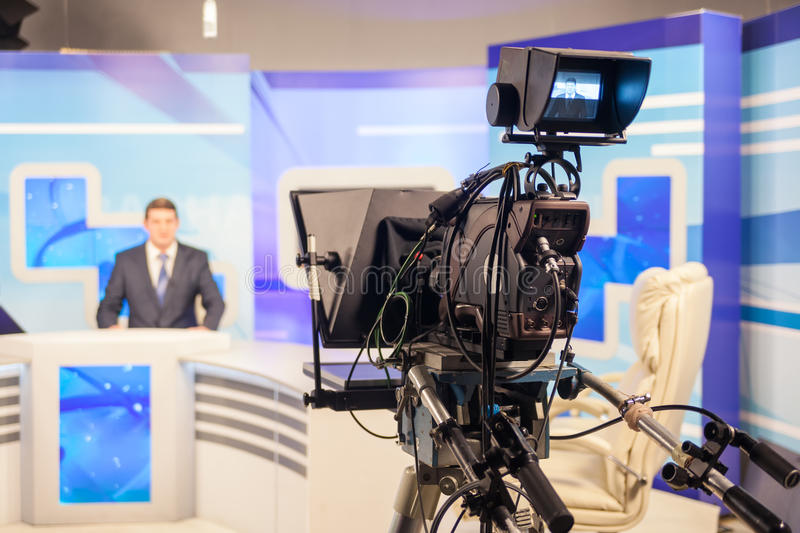 Tv camera recording male reporter or anchorman. Live broadcasting stock photo