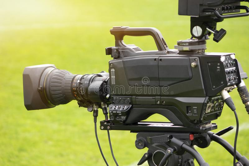 TV camera at the stadium, broadcasting during a football stock image