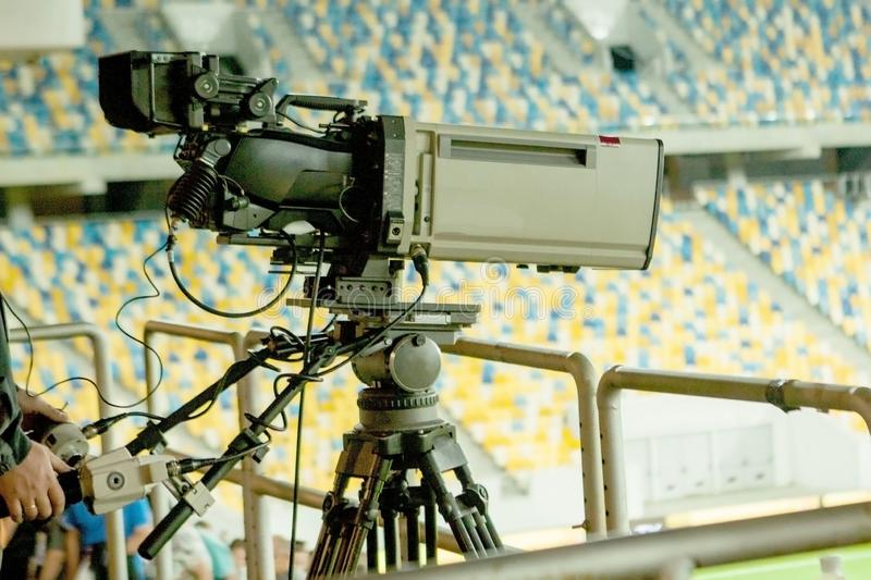 TV camera at the stadium during football matches stock photo