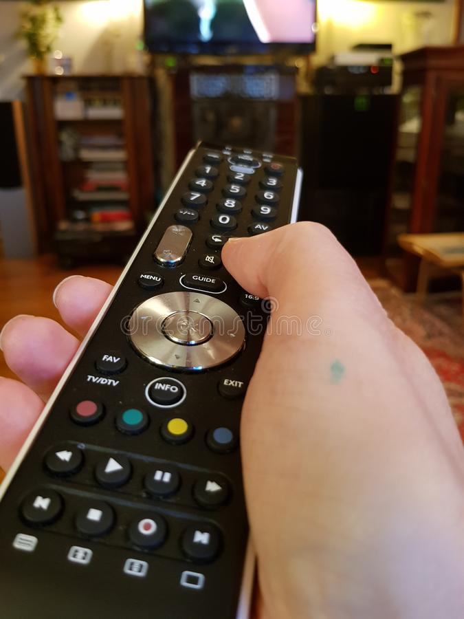 tv control panel in hand royalty free stock image