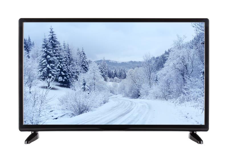 TV de alta definición moderna con la imagen del landscap del invierno fotos de archivo libres de regalías