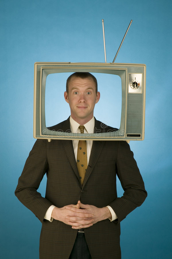 TV Head. Man in a suit making a funny face with a retro tv set on his head stock photography