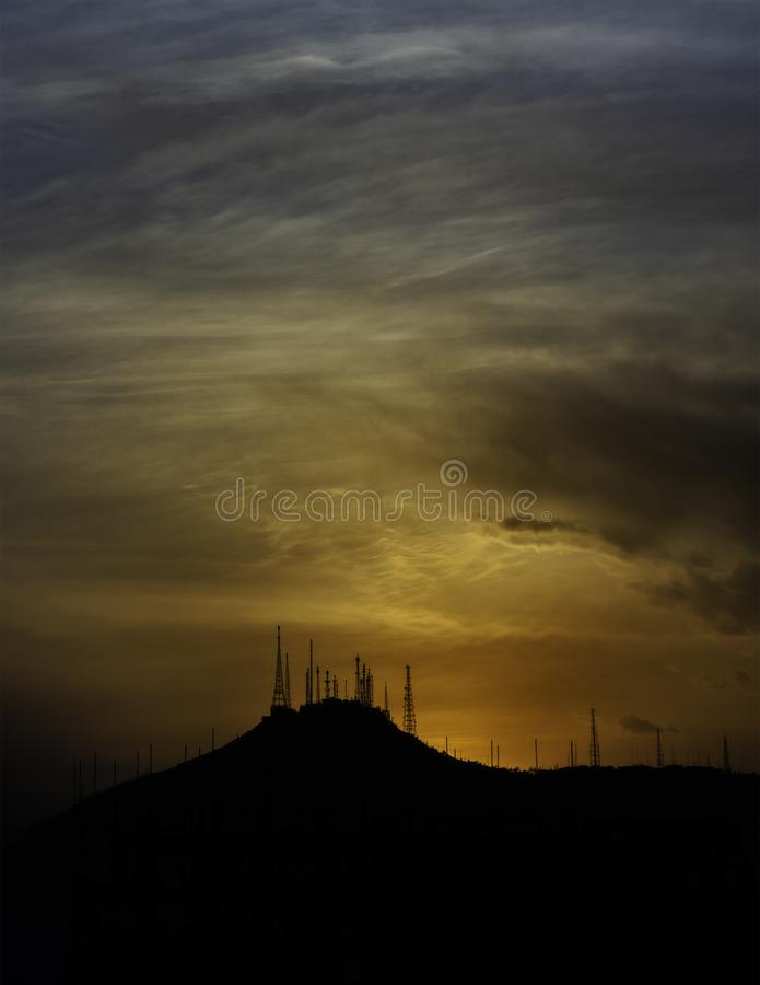 TV Hill, Kabul Afghanistan - Dramatic Sunset. Orange, yellow, purple and pink - moody stock image