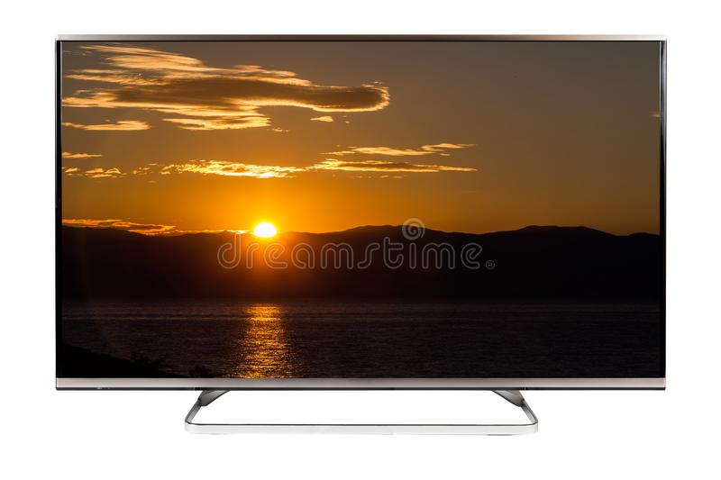 TV - 4K resolution modern television. With sunset on it royalty free stock photos