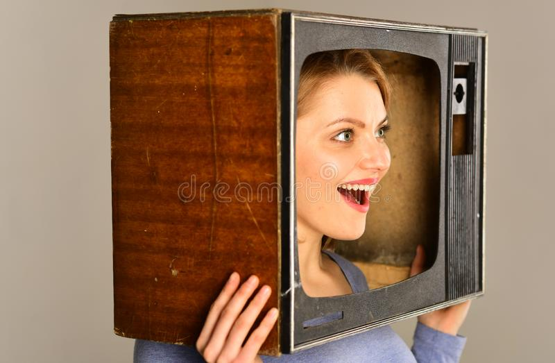 Tv maintenance. tv maintenance for everyone. tv maintenance services. woman in tv set, maintenance. cheering for stock photography