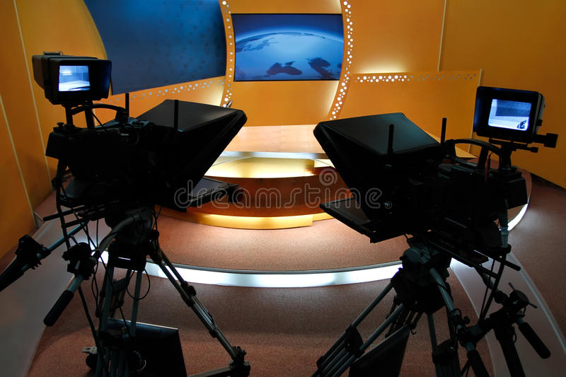 TV news studio. Television studio with news desk, camera prompter and professional lightning